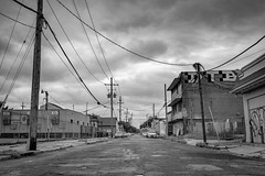 New Orleans Suburbs (Mark van Oirschot) Tags: city new orleans neworleans street louisiana fuji fujixt10 fujifilm downtown citylife bw blackandwhite electricity suburbs hood broken damaged fallen graffiti pole neighborhood clouds chrome dark alley