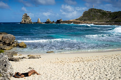 guadeloupe france (chrisimages1) Tags: beach sun sea ocean guadeloupe clouds nuages girl woman swimmsuit black westindies sand plage bain cross croix rochers rock sony a7 samyang full frame 35mm lightroom adobe blue rocks lens prime af travel isle
