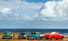 Classic Line Up - Havana (sminky_pinky100 (In and Out)) Tags: cuba havana classiccars sea landscape lineup blue green red clouds outdoors travel tourism omot cars vehicles lada