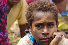Young boy staring into the distance (eomer1) Tags: papua new guinea scripture celebration papuanewguinea boy child yellow