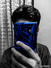 Blue in a Noir World (shamahzoha) Tags: selfie selfportrait mirror selectivecolor blue cellphone mobile mobilephotography mono duotone glass reflection reflective hand face covered abstract 52weekschallenge dogwood52 dogwood2018 dogwoodweek10 head person fingers postprocessed hss slidersunday