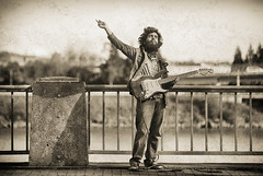 Waiting For it....... (Ian Sane) Tags: ian sane images waitingforit man guitarist street performer musician candid photography monochrome sepia governor tom mccall waterfront park portland oregon willamette river canon eos 5ds r camera ef70200mm f28l is usm lens