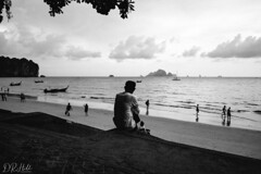 Looking out to sea (D. R. Hill Photography) Tags: thailand asia southeastasia monochrome blackandwhite bokeh candid street streetphotography thai krabi aonang beach sea seafront seaside coast sand andamansea travel nikon nikond750 d750 nikon28mmf18g 28mm wideangle primelens fixedfocallength vsco vscofilm