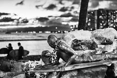 Surfer and seal sculpture (Guy: Jussum Guy) Tags: blackandwhite monochrome people waikiki sculpture surfer seal sunset honolulu oahu hawaii pentax k3