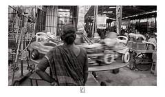 Wheel ride (krishartsphotography) Tags: krishnansrinivasan krishnan srinivasan krish arts photography monochrome fineart fine art wheel ride spin spinning market temple affinity photo mylapore chennai tamilnadu india street