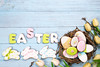 Beautiful e tulips with colorful eggs in nest and cookies as bunny on blue wooden background and cookies lettering Happy Easter (lyule4ik) Tags: easter background nest wood spring white celebration colorful decoration holiday green design nature rustic closeup natural color decorative happy season seasonal traditional wooden eggs flower gift pattern retro table texture petals posy old empty symbol surface stone topview bouquet mother space valentine egg food vintage orange festive basket quail greeting