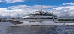 Passing strangers (idunbarreid) Tags: boats boat sky water vessel australia queensland tangalooma moretonisland wavepiercer ferriesacrossaustralia tangaloomajet