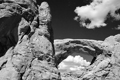 Pair of Holes (NaturalLight) Tags: southwindow arch clouds eyeinthesky monochrome bw archesnationalpark utah