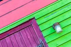 A Painted House (Karen_Chappell) Tags: house home purple pink green door architecture tilt angle colourful multicoloured light lamp lines geometry geometric stjohns jellybeanrow downtown city urban paint painted wood wooden clapboard colours colour color newfoundland nfld atlanticcanada