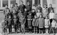Class photo (theirhistory) Tags: children kids boys school girls jacker skirt trousers jumper coat wellies dress boots
