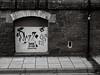 20171029-100303 (aderixon) Tags: architecturewallstone artgraffiti transportpavement aberystwyth ceredigion walesuk ianisgod stencil