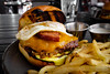 Burger w/ cheddar, chorizo, hash browns, garlic aioli, and fried egg - Table 9 (sheryip) Tags: burger food foodporn morgantown wv wvu sher yip chorizo tuesday fries