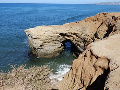 Rock, with arch, Sunset Cliffs (Martin LaBar) Tags: california sandiegocounty sandiego sunsetcliffs pacificocean rocks arch erosion cliff waves surf water