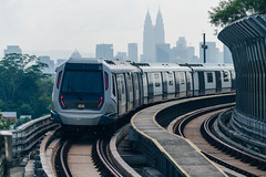 Mass Rapid Transit (MRT) train with background of cityscape in Kuala Lumpur. MRT system forming the major component of the railway system in Kuala Lumpur, Malaysia. (MongkolChuewong) Tags: 2018 architecture asia asian background business center city cityscape corporate destination east economy estate famous fast financial futuristic glass highway home kl klcc kuala landmark lumpur malaysia malaysian mass metro modern mrt office outdoor railway rapid sky skytrain station system tourism tower train transit transportation travel united urban vehicle view
