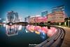 Urban Bling (Andy Brandl (PhotonMix)) Tags: china asia hangzhou architecture illuminated leds modern futuristic reflections water pool bridge skyscrapers nikon photonmix