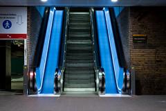 Glissade bleue (urban requiem) Tags: escalator escalators bleu blue escalier escaliers stairs treppe staircase france paris la défense defense archi urbain city ville architecture nuit by night lights lumière pose longue long exposure