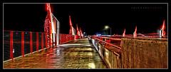 State Street Bridge (J Michael Hamon) Tags: statestreetbridge bridge columbusindiana indiana bartholomewcounty nightphotography widescreen architecture red hamon nikon d3200 sigma 1020mm longexposure tonemapping outdoor blackbackground photoborder hawcreek perspective vanishingpoint