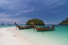 A pearl of the Andaman Sea. (Gergely_Kiss) Tags: andamansea whitesandbeach traditionalboats longtailboat tupisland thailandholiday paradise thaiislets thaiislands thaibeaches thailand krabi