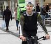 Uberman (Nikonsnapper) Tags: olympus omd em1 75mm zuiko street colour cardiff headphones uber bag cyclist
