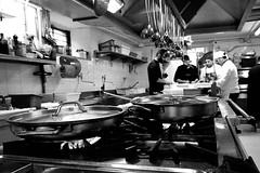 Lavori in corso (luporosso) Tags: cucina kitchen cuochi chef cibo food italia italy italianfood lavoro work bnw bn biancoenero bianconero blackwhite monocromatico monochromatic