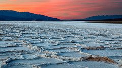 Badwater Sunset (Kirk Lougheed) Tags: badwaterbasin blackmountains california deathvalley deathvalleynationalpark panamintmountains usa unitedstates landscape mountain nationalpark outdoor park saltflat saltpan sunset