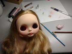 Mini-me Blythe doll. Her base is a winterish allure.