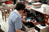 1a-176 (ndpa / s. lundeen, archivist) Tags: nick dewolf nickdewolf photographbynickdewolf 1977 1970s color 35mm film 1a reel1a austin tx texas motorola semiconductor plant motorolasemiconductor semiconductorplant ic integratedcircuitry integratedcircuit chip chips electronics manufacture manufacturingprocess equipment chair desk console seated sitting woman worker working employee uniform microscope workroom workspace lab laboratory workstation