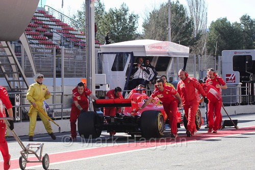 Sebastian Vettel's car is pushed back down the pit lane at Formula One Winter Testing 2018