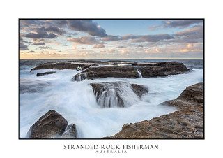 Stranded  Rock Fisherman almost taken by the ocean