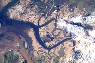 River meets ocean near Rockhampton, Australia