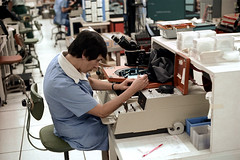 1a-174 (ndpa / s. lundeen, archivist) Tags: nick dewolf nickdewolf photographbynickdewolf 1977 1970s color 35mm film 1a reel1a austin tx texas motorola semiconductor plant motorolasemiconductor semiconductorplant ic integratedcircuitry integratedcircuit chip chips electronics manufacture manufacturingprocess equipment chair desk console seated sitting woman worker working employee uniform microscope workers employees workroom workspace lab laboratory watch wristwatch workstation