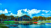 The clubhouse (Paul Wrights Reserved) Tags: landscape sky skyscape bluesky scene scenic scenery trees building water lake boat boats canoe clouds cloudscape
