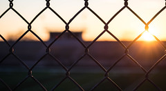 Sun Interlinked (1 of 1) (cpalka87) Tags: utah ogden sun sunset fence linked football field bleachers motivation interlinked chain motivational
