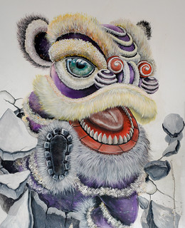 Lion dance breaking out of wall