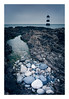 Penmon Pebbles (Ollie Pocock) Tags: anglesey wales north uk long exposure sea beach seaside grey blue lighthouse rocks pebbles water coast coastal seascape pebble sky rock