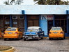 In between (Jean S..) Tags: cars old taxi blue yellow garage street outdoors parking