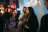 Night out 133/156 (markfly1) Tags: girls night out smoking telephone pensive waiting line colour blue yellow red orange puff smoke cigarette fur coat shapes queuing treet photography candid wide open beautiful pretty women ladies nikon d750 50mm