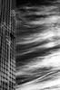 A contre sens... (Janick Lanier) Tags: nuages clouds nb bw janicklanier vertical sky building ladéfense