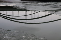 Three arches over melting ice (Sven Bonorden) Tags: dortmundemskanal kanal channel water ice eis wasser gefroren frozen winter brücke bridge spiegelbild spiegel mirror mirrored eisschollen arches bögen three drei dortmund ruhrgebiet westfalen nordrheinwestfalen deutschland germany canon grau grey a2 autobahnbrücke