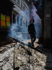 Ghost in the Ashes (SaumalyaGhosh.com) Tags: ghost ashes man dark fire ash color lane street streetphotography india benaras varanasi nikon d610