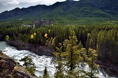 Bow River and the Banff Springs Hotel from Surprise Point (Banff National Park) (thor_mark ) Tags: banffnationalpark banffspringshotel bowfalls bowriver bowvalley canadianflag canadianrockies canvas capturenx2edited colorefexpro day2 evergreens flag flagpole flickridea hillsideoftrees hillsides hotel ideasigotfromothers landscape lookingssw mountains mountainsindistance mountainsoffindistance mountainside nature nikond800e outside overcast portfolio project365 river rockymountains rollinghillsides southbanffranges southerncontinentalranges sulphurmountain surprisecorner surprisepoint trees triptoalbertaandbritishcolumbia alberta canada