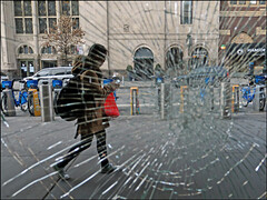 Shattered - Brooklyn, NYC (TravelsWithDan) Tags: candid streetphotography woman window brokenglass shattered throughtheglass street city urban outdoors walking sidewalk buildings brooklyn nyc newyork canong16 texting mobiledevice atlanticterminal fortgreene ngc