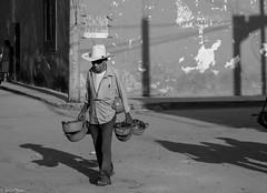 vendedor de cazuelas (guilletho) Tags: blackandwhite blancoynegro noiretblanc blackwhite monochrome mexico traditions traveling people monocromatico man tradiciones canon streetphoto streetseller estreetphotograpy