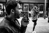 Bad Language (Silver Machine) Tags: streetphotography street candid man leatherjacket beard phone phonecall parentaladvisoryexplicitcontent profile girl walking mono monochrome blackwhite bw fujifilm fujifilmxt10 fujinonxf35mmf2rwr