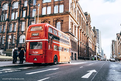 Glasgow, Scotland, UK – March 9, 2018:  : Famous London red bus as a Cafe Bus on the city street in Glasgow, Scotland, UK (CreativePhotoTeam.com) Tags: glasgow scotland city street building architecture great united kingdom old people travel tourism square landmark uk europe european exterior town historical cityscape scottish britain road centre urban retro traffic house bus london red england double british transport english vintage decker routemaster famous capital transportation history symbol iconic aec traditional color