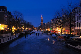 Ice skating in the evening of Amsterdam