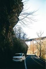 Geology van under a cliff (ryandoddlol) Tags: outdoors clif van truck om10 olympus sedimentary professional professor rocks university college geology xtra supira fuji anolog film road car