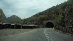 gopr4704_006_v1 (Mr. Pi) Tags: mountains tunnel hills road stall roadside ontheroad dirtywindow southafrica