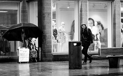 2018_071 (Chilanga Cement) Tags: fuji fujix100f fujifilm bw blackandwhite monochrome street candid preston prestonstreetphotography fishergate rain dog puppy man glance looking walking bigissue