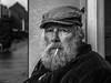 Russell (Silver Machine) Tags: andover hampshire streetphotography street streetportrait man smoking flatcap beard portrait outdoor urbanportrait artist mono monochrome blackwhite bw fujifilm fujifilmxt10 fujinonxf35mmf2rwr